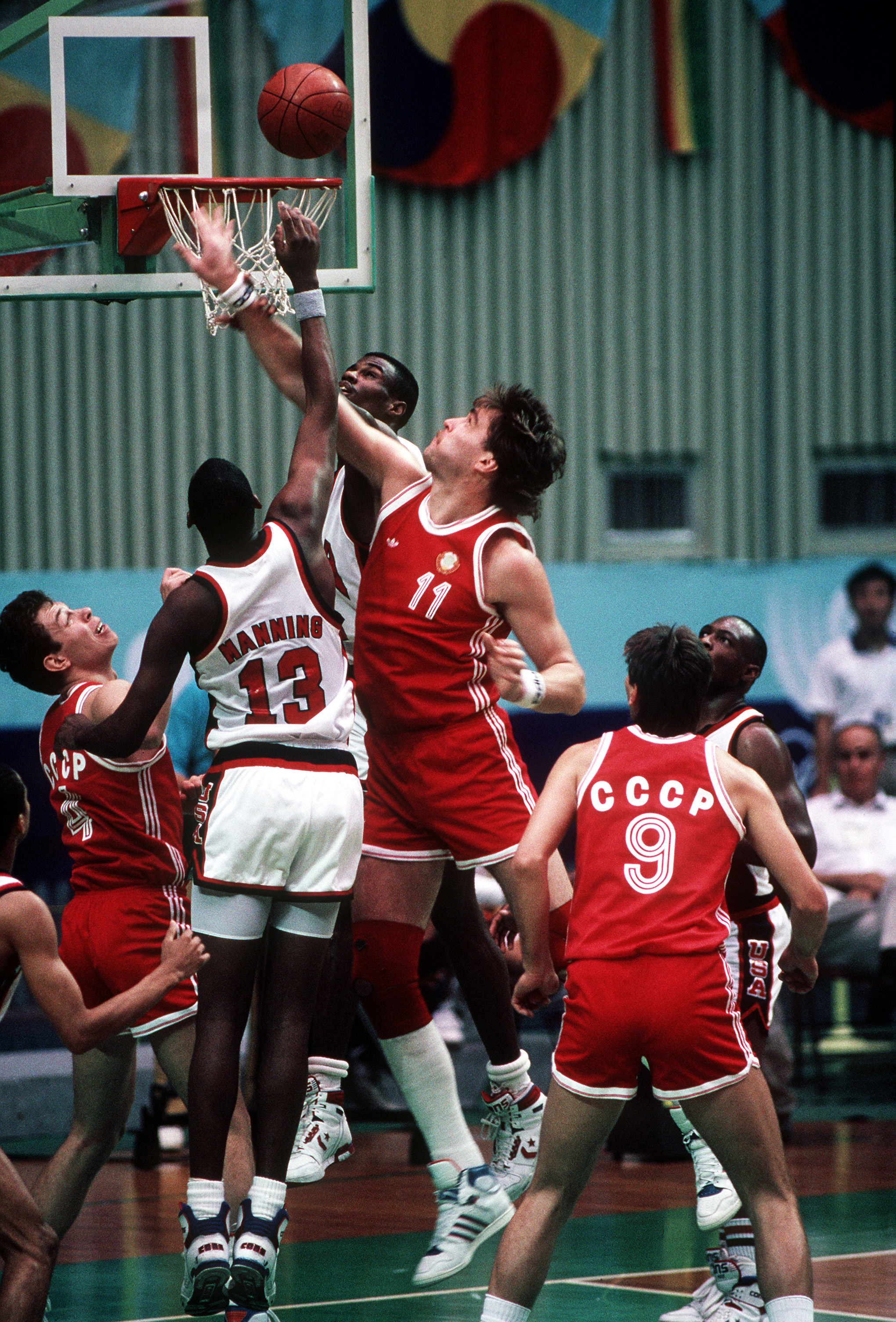 Danny Manning and the Navy's David Robinson battle a Soviet player for a rebound during the Soviet upset over the US basketball team at the XXIVth Olympiad.