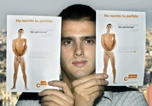 "Albert Rivera, a 26-year old lawyer, holds up two campaign posters showing himself naked,  in Barcelona, Spain, Sept. 20, 2006. Plenty of politicians promise to tell the naked truth, but Albert Rivera is taking the cliche literally, appearing nude on a campaign poster as he runs for president of Catalonia. On thousands of posters adorning the streets of Barcelona and other Catalan cities, Rivera is shown naked as the day he was born, covering himself,  fig-leaf style to keep the poster family-friendly. Beside the photo, a caption reads: ""We don't care where you were born. We don't care which language you speak. We don't care what kind of clothes you wear. We care about you"". (AP Photo/Manu Fernandez)"
