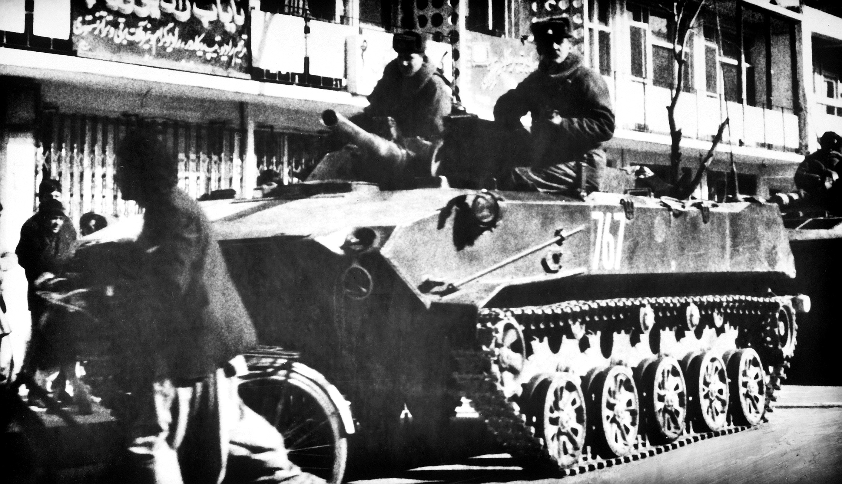 Soldiers ride aboard a Soviet BMD airborne combat vehicle.