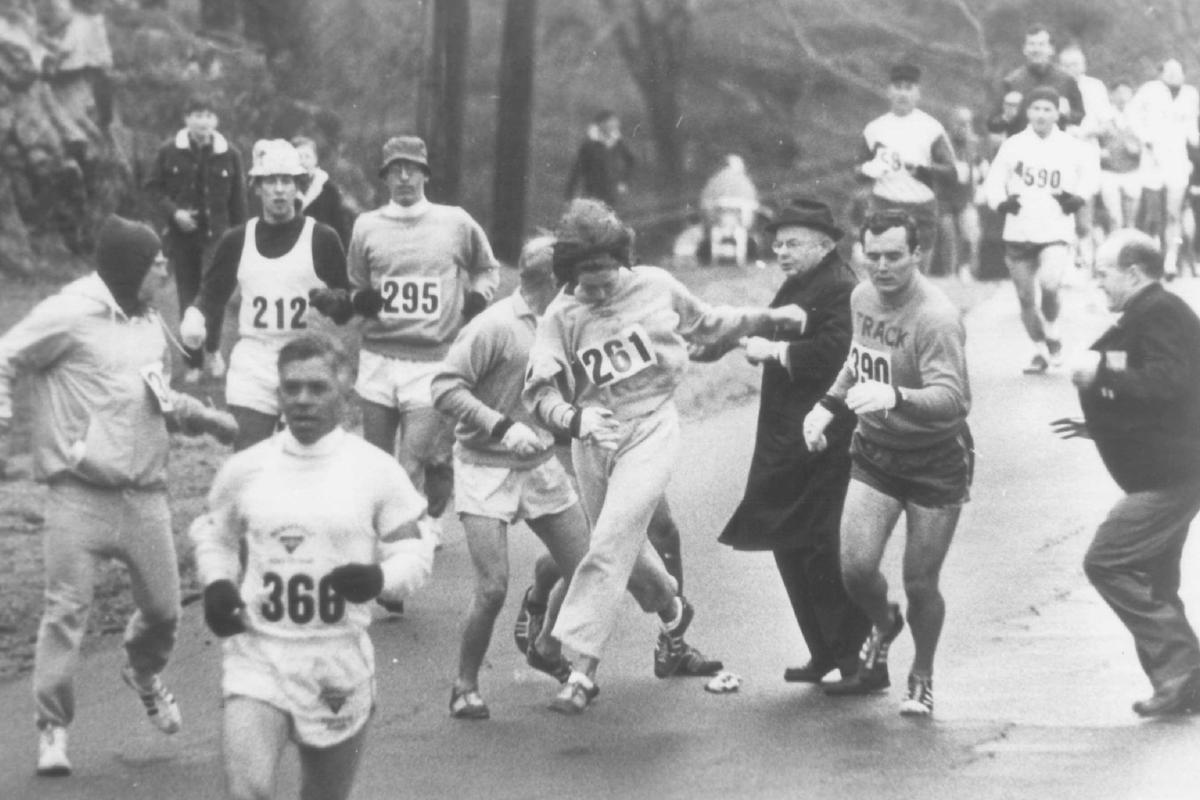 Kathy Switzer, one of two women in the normally an-male Boston marathon in 1967, evades Marathon Director Bill Clooney (in dark suit), who attempted to stop her from running. Ms. Switzer is among the co-anchor persons of the WGBH production,   THE BOSTON MARATHON, _ at _ on Channel _.