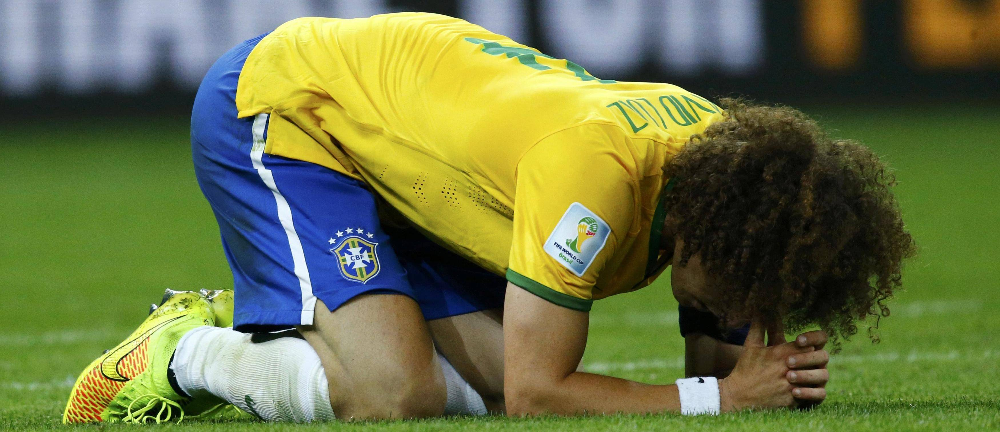Brazil's David Luiz reacts after their 2014 World Cup semi-finals against Germany at the Mineirao stadium in Belo Horizonte
