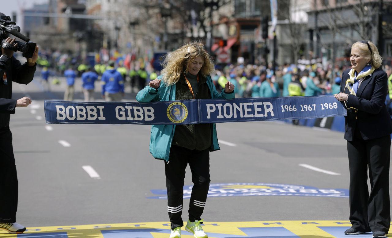 Bobbi Gibb, first woman to run the Boston Marathon in 1966, crosses at the finish line of the 120th Boston Marathon on Monday, April 18, 2016, in Boston. (AP Photo/Elise Amendola)